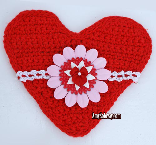 Crocheted Heart Embellished With Lace Trim, Flowers and Satin Bow -- Free Crochet Patterns Are Available for Both the Heart and the Lace Trim.