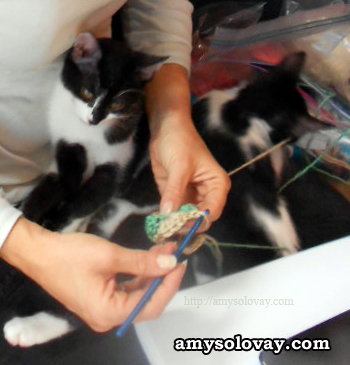 OK Iz, I'll show you how to you crochet. Look here. This is how you make a single crochet stitch...