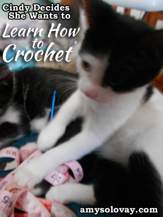 Cindy says, Mommy, I'm going to learn how to crochet! She grabs my crochet hook and begins wrestling with my tape measure.