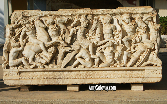 Roman Sarcophagus Dating Back to the Third Century AD.  The marble sculptures on three sides of this piece depict a battle between the Romans and the Barbarians. On the fourth side, lions are pictured attacking bulls. This artifact is on display at the antiquities courtyard museum in Ashkelon, Israel.