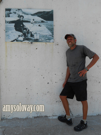 Mike with an old Greek picture we saw on the wall in the marina at Agia Galini, Crete.